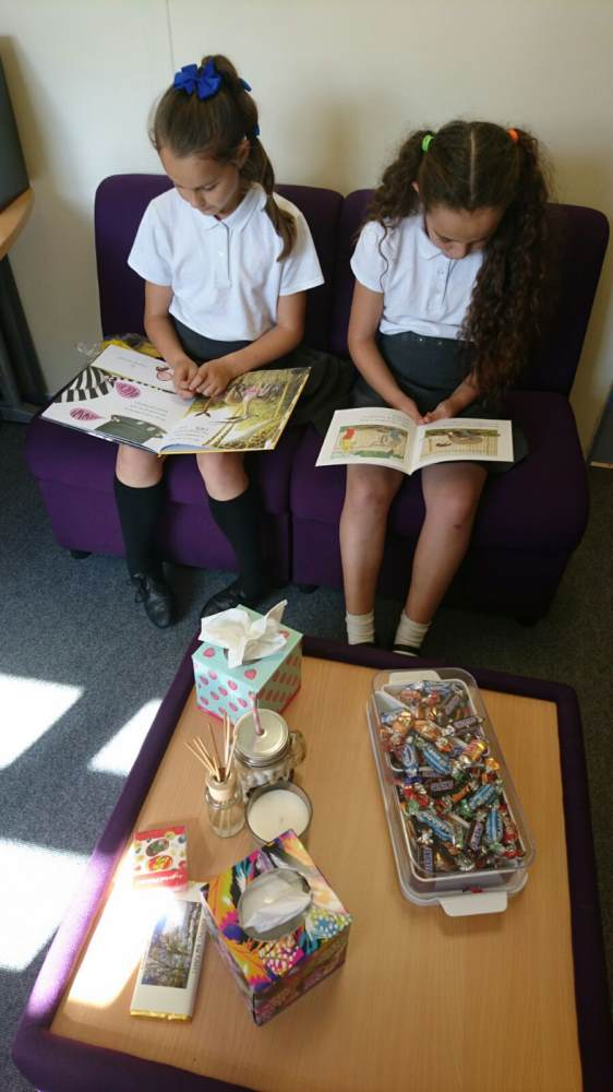 Pupils reading in Mrs Unsworth's office